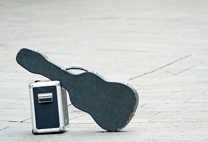 Black guitar with amplifier isolated abandoned